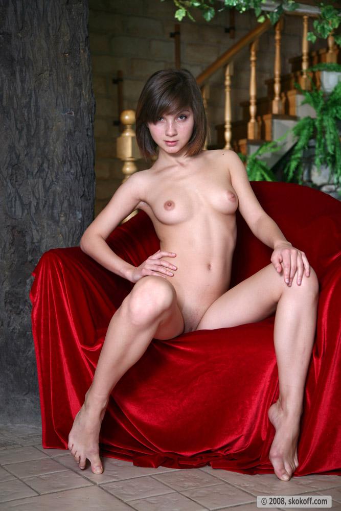 Teen stunner Vera lets a red blanket highlight her body